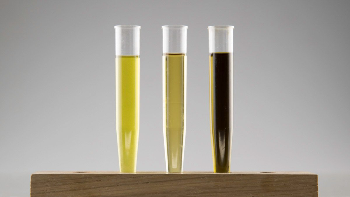 Three glass tubes with CBD oil next to each other