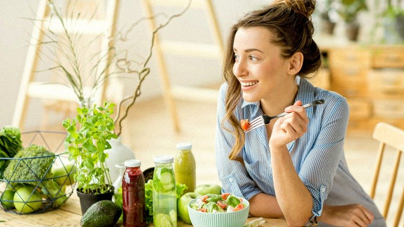 Young woman eating healthy foods