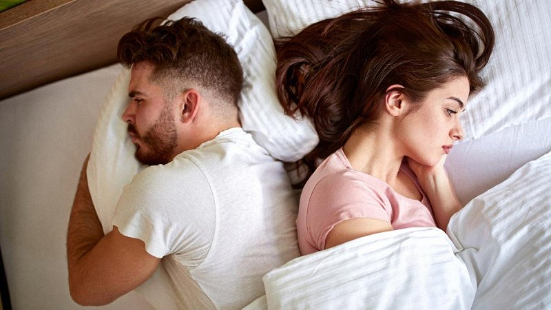 Depressed Couple in Bed