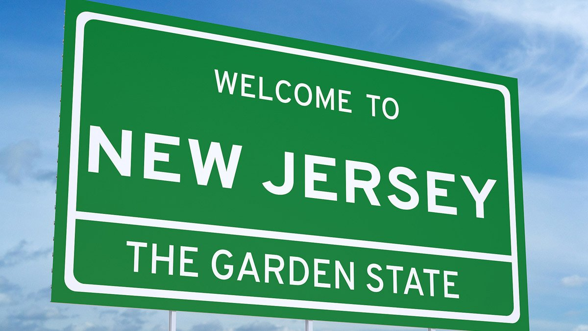 New Jersey State Sign on blue sky background